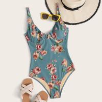 Слитный купальник на косточках с цветочным принтом