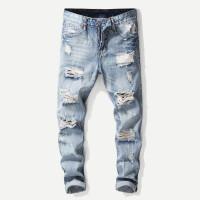 Рваные полотняные джинсы для мужчины