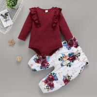 Комбинезон и цветочные брюки с присборенной талией