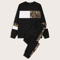 Мужские спортивные брюки и контрастный леопардовый пуловер